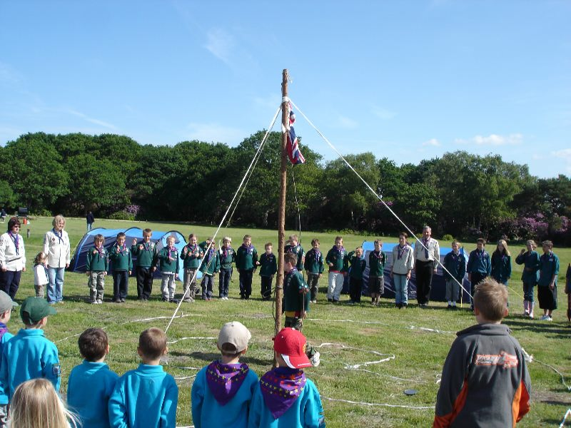 Beavers Cubs and Scouts around the flag pole